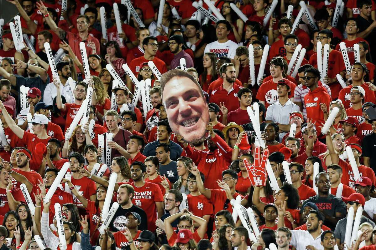 A picture of Houston head coach Tom Herman is raised in the crowd during the first quarter of an NCAA football game against Connecticut at TDECU Stadium on Thursday, Sept. 29, 2016, in Houston. ( Brett Coomer / Houston Chronicle )