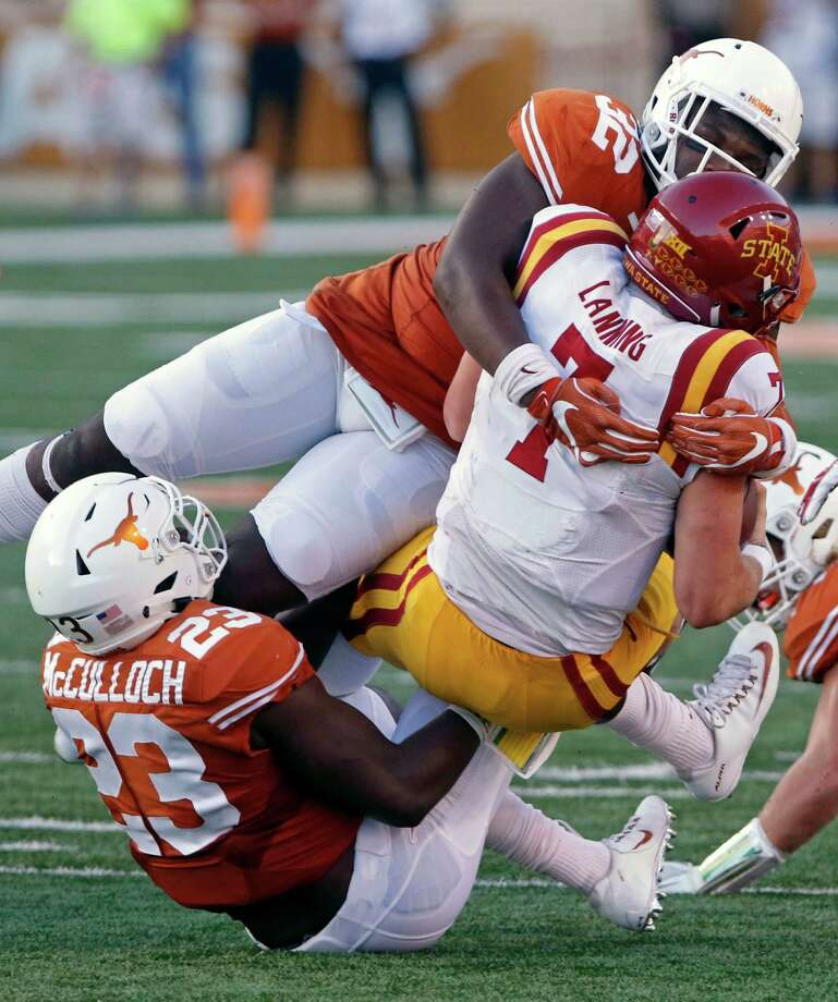 Iowa State quarterback Joel Lanning (7) is tackled by Texas' Malcolm Roach (32) and Jeffrey McCulloch (23) during the first half of an NCAA college football game, Saturday, Oct. 15, 2016, in Austin, Texas. (AP Photo/Michael Thomas) Photo: Michael Thomas, FRE / FR65778 AP
