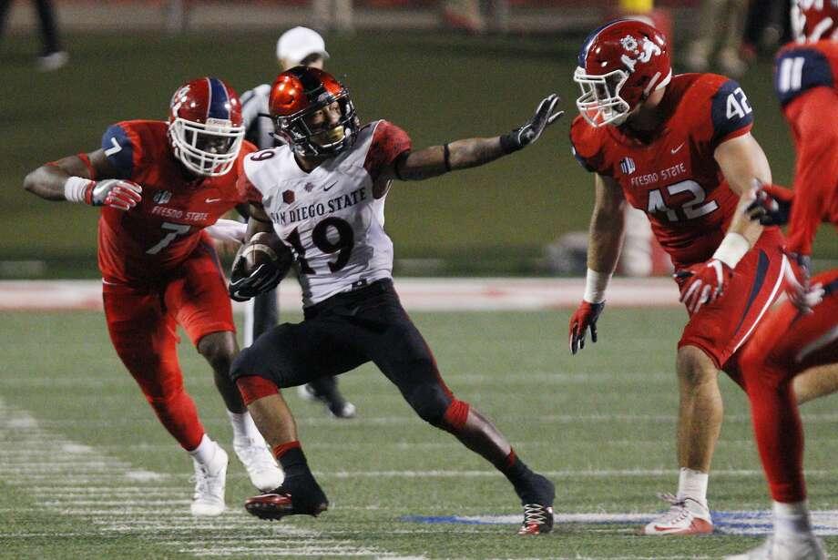 San Diego State's Donnel Pumphrey runs pass Fresno State's Jeff Camilli during the second half of an NCAA college football game in Fresno, Calif., Friday, Oct. 14, 2016. (AP Photo/Gary Kazanjian) Photo: GARY KAZANJIAN, Associated Press