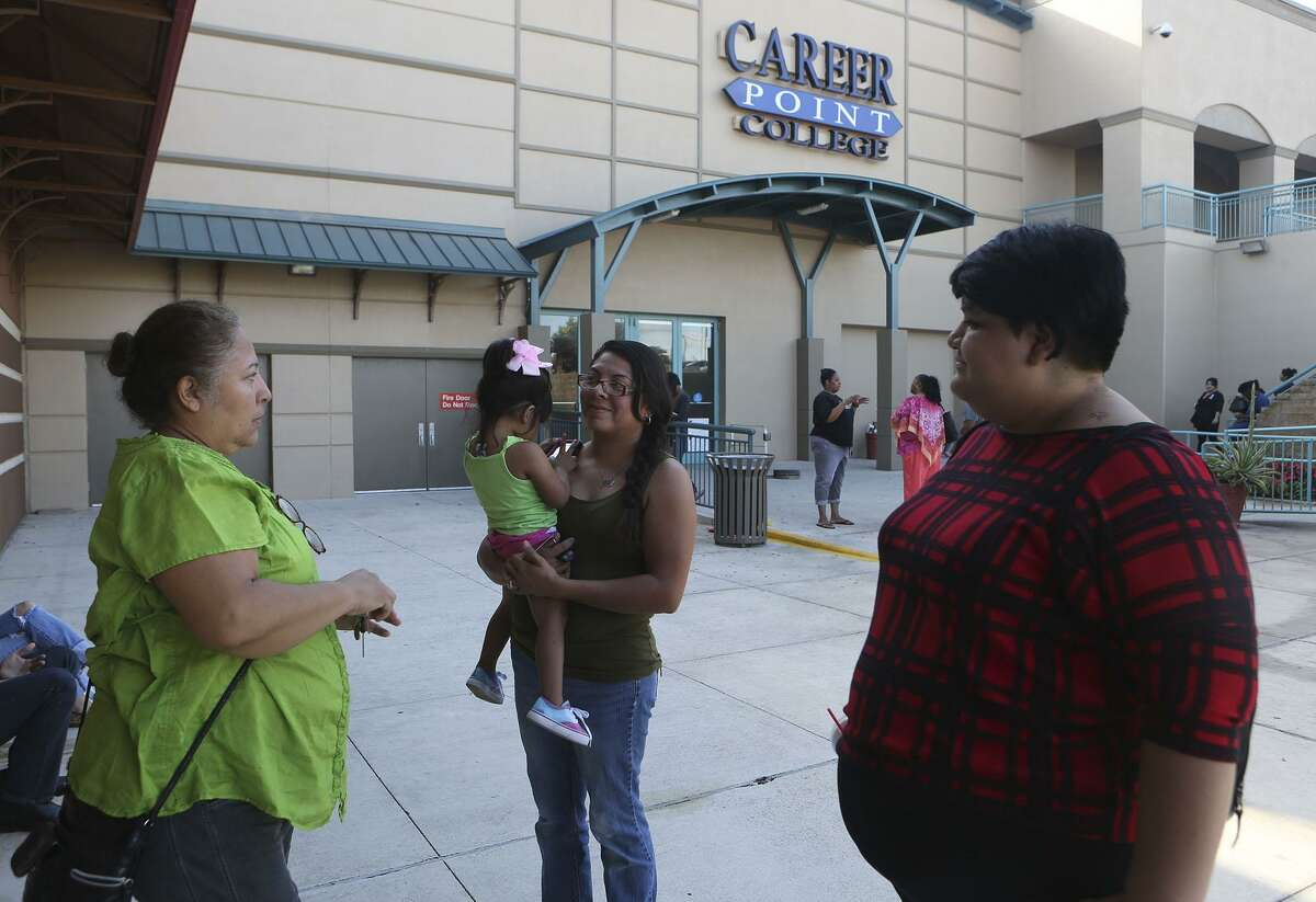Former Career Point College students Rose Costello (left), Melanie Mireles (center), and Marianna Perez (right) stand outside of the school Monday October 17, 2016 after the for-profit school shut its doors. A letter sent to students and teachers from its president and CEO said the school is shutting its doors after management discovered that three long-term employees had