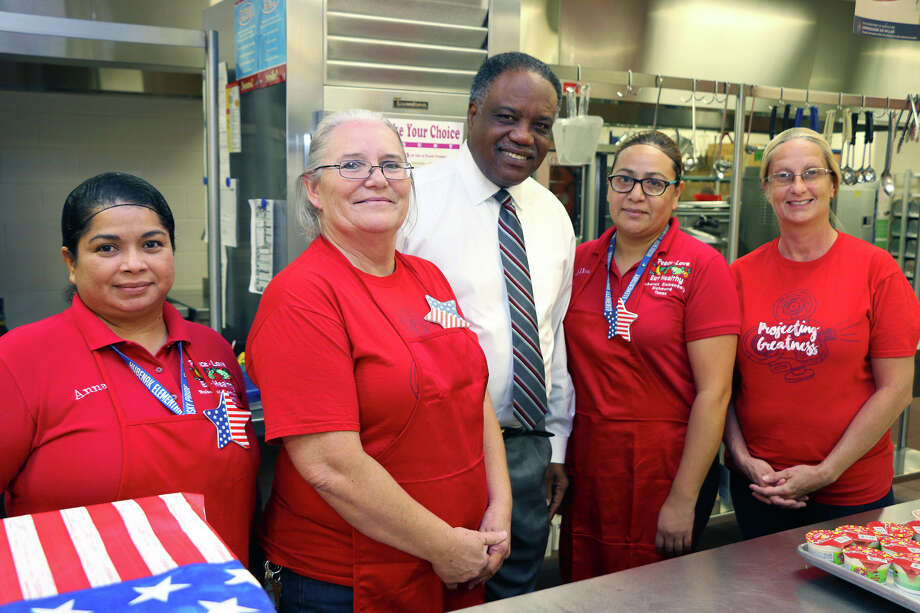 In the kitchen at Hubenak Elementary, preparing for National School Lunch Week, are Anna Aguilar, Darline Weist, Lamar CISD Superintendent Dr. Thomas Randle, Rosalba Medina and Crystal Kilburn. Photo: Lamar CISD