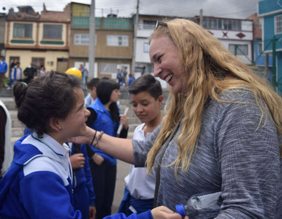"A student from a school served by the Conviventia nonprofit in Colombia embraces a team member from the nonprofit during an ""Environmental Service Day with Students"" in Bogota, Colombia on Sept. 14, 2016. Photo: Conviventia"