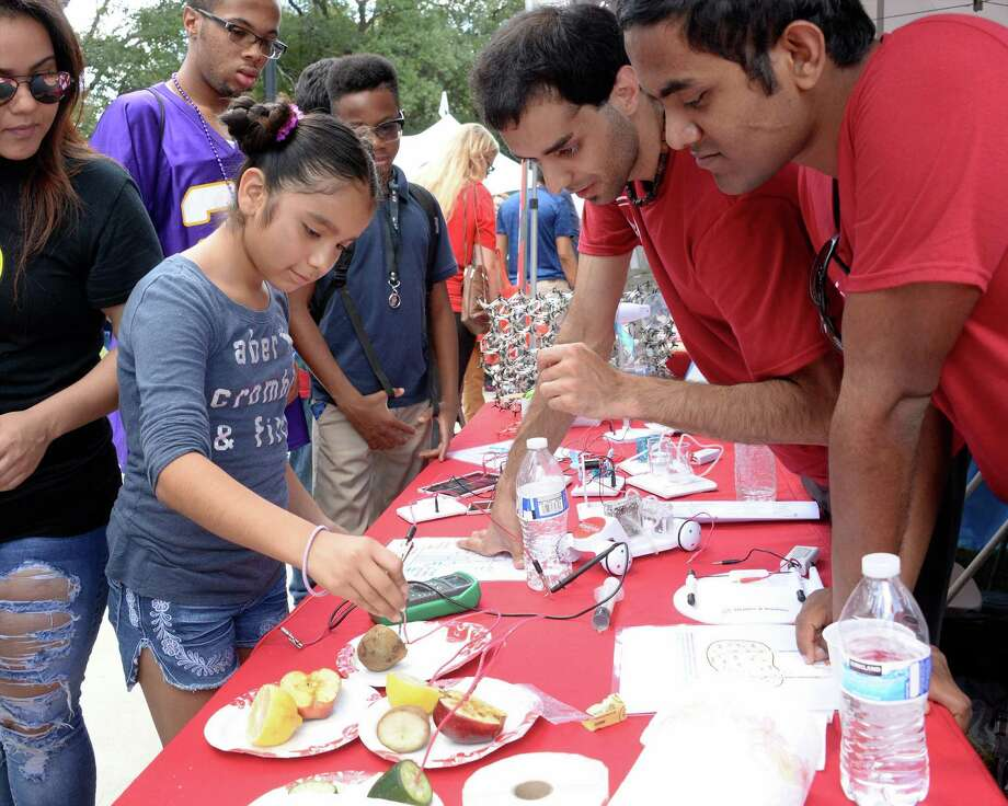 Families turned out for the annual Energy Day Festival on Oct. 15 at Sam Houston Park. It is Houston's largest annual free family festival showcasing science, technology, engineering and mathematics Photo: Craig Moseley, Staff / ©2016 Houston Chronicle