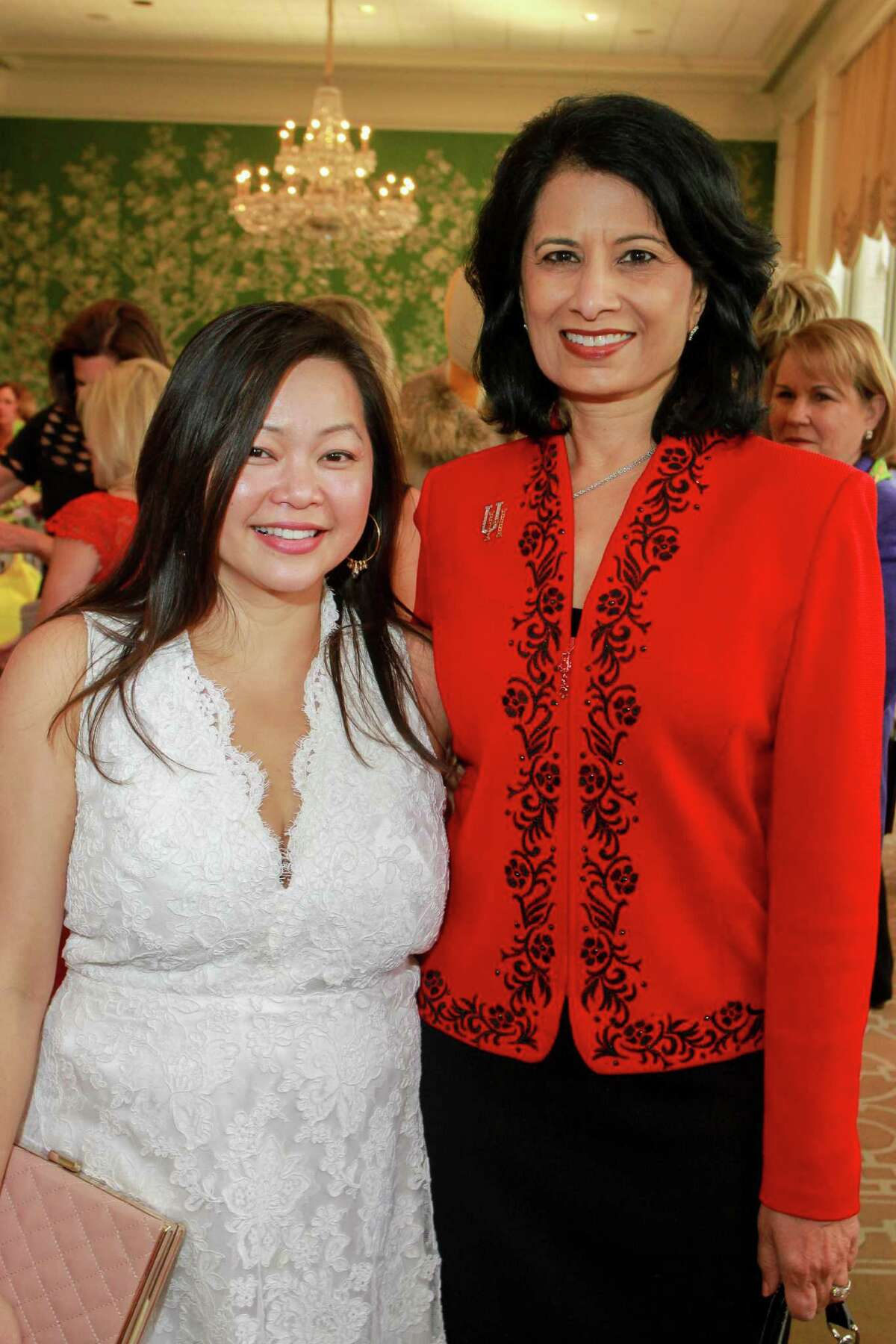 Chloe Dao, left, and Dr. Renu Khator at the annual Chic Boutique and runway fashion show luncheon benefiting the Salvation Army. (For the Chronicle/Gary Fountain, April 12, 2016)