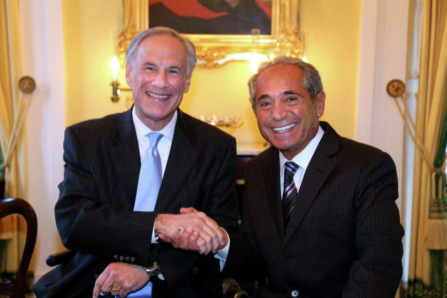 From left are Texas Gov. Greg Abbott and Carmelo Mauro. Photo: Rusty Graham