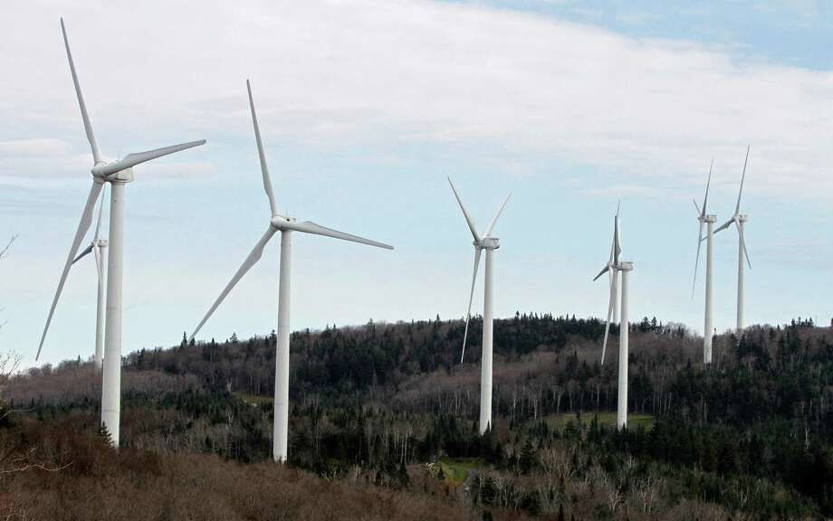 FILE- In this Oct. 26, 2011 file photo, wind turbines line the hillside at First Wind's project in Sheffield, Vt. Government officials in Vermont, Canada and Australia have dismissed concerns about the health effects of noise from wind power turbines, but don't tell that to people living near them. Now a Vermont home abandoned by a family who said they were made ill by nearby turbines will be used for sound-monitoring research. (AP Photo/Toby Talbot, File) Photo: Toby Talbot, STF / Copyright 2016 The Associated Press. All rights reserved.