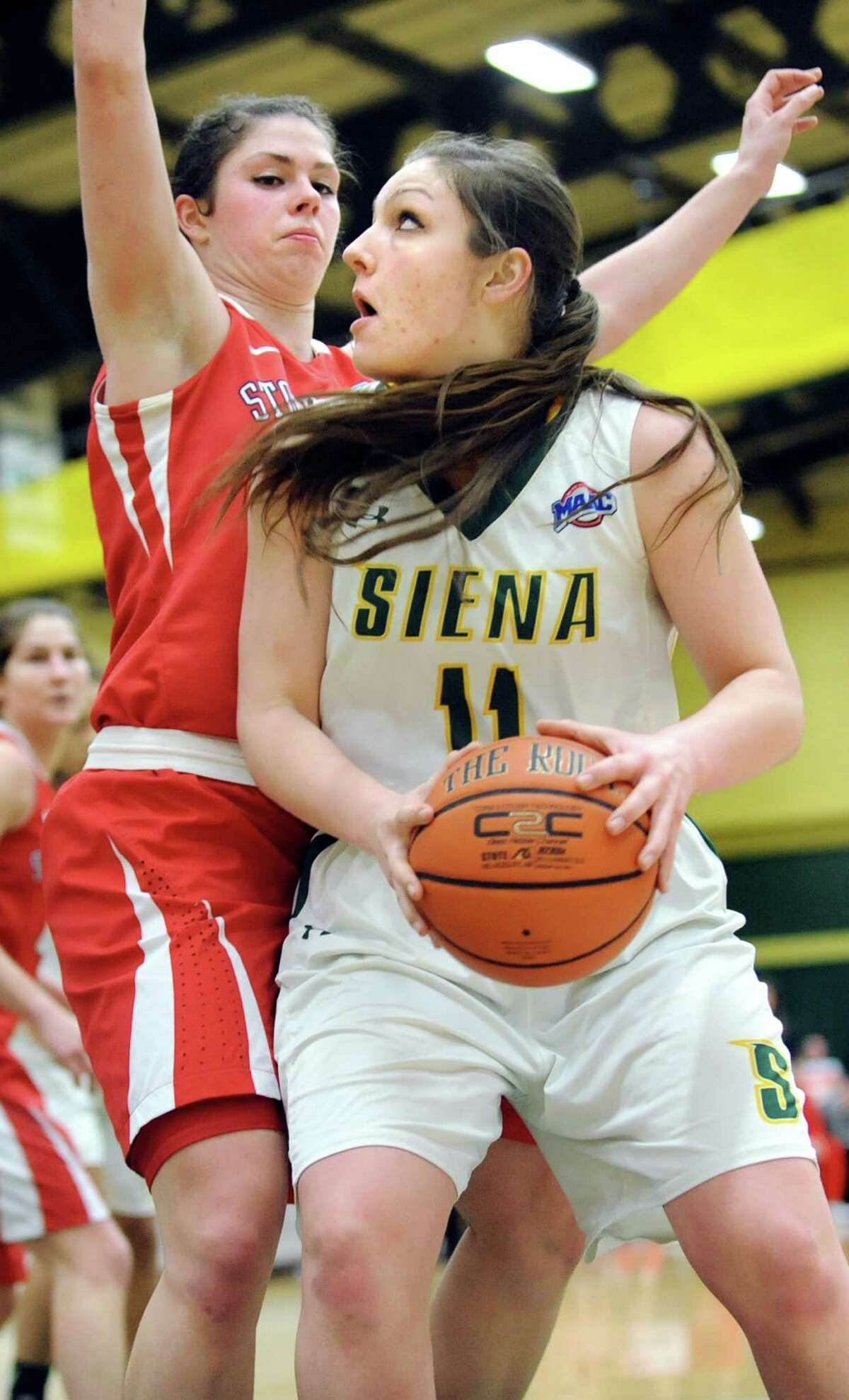 Siena's Margot Hetzke, right, looks to the hoop as Stony Brook's Brittany Snow defends during the Women's Basketball Invitational on Thursday, March 19, 2015, at Siena College in Loudonville, N.Y. Siena wins 53-46. (Cindy Schultz / Times Union)
