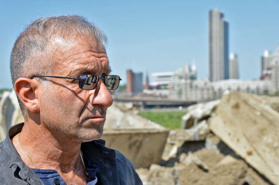 SUNY Polytechnic Institute President and CEO Alain Kaloyeros during a tour of the vacant waterfront lot where the Rensselaer High School once stood Thursday May 7, 2015 in Rensselaer. (John Carl D'Annibale / Times Union)
