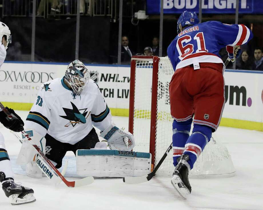 New York Rangers's Rick Nash (61) shoots the puck past San Jose Sharks goalie Martin Jones (31) during the second period of an NHL hockey game Monday, Oct. 17, 2016, in New York. (AP Photo/Frank Franklin II) ORG XMIT: MSG107 Photo: Frank Franklin II / Copyright 2016 The Associated Press. All rights reserved.