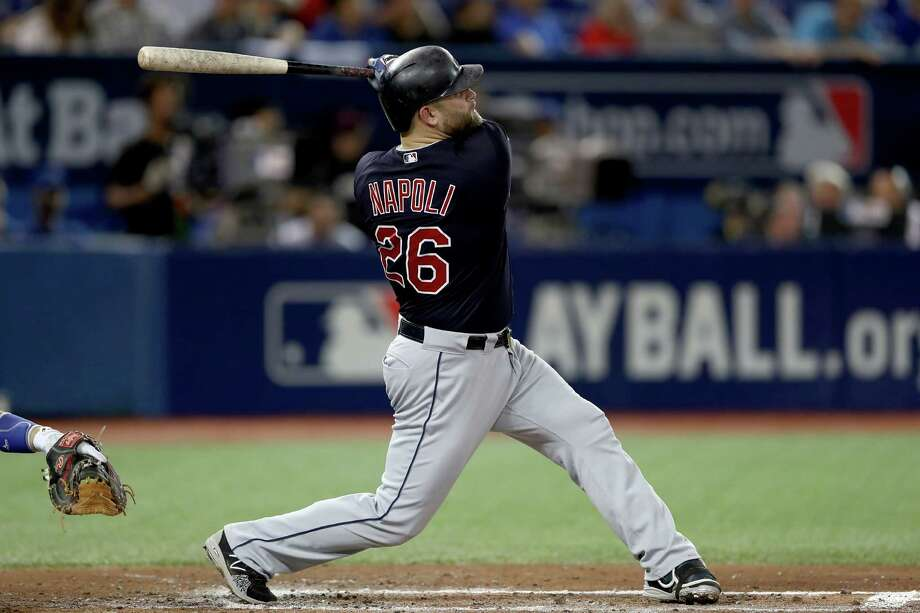 TORONTO, ON - OCTOBER 17:  Mike Napoli #26 of the Cleveland Indians hits a solo home run in the fourth inning against Marcus Stroman #6 of the Toronto Blue Jays during game three of the American League Championship Series at Rogers Centre on October 17, 2016 in Toronto, Canada.  (Photo by Elsa/Getty Images) ORG XMIT: 676240193 Photo: Elsa / 2016 Getty Images