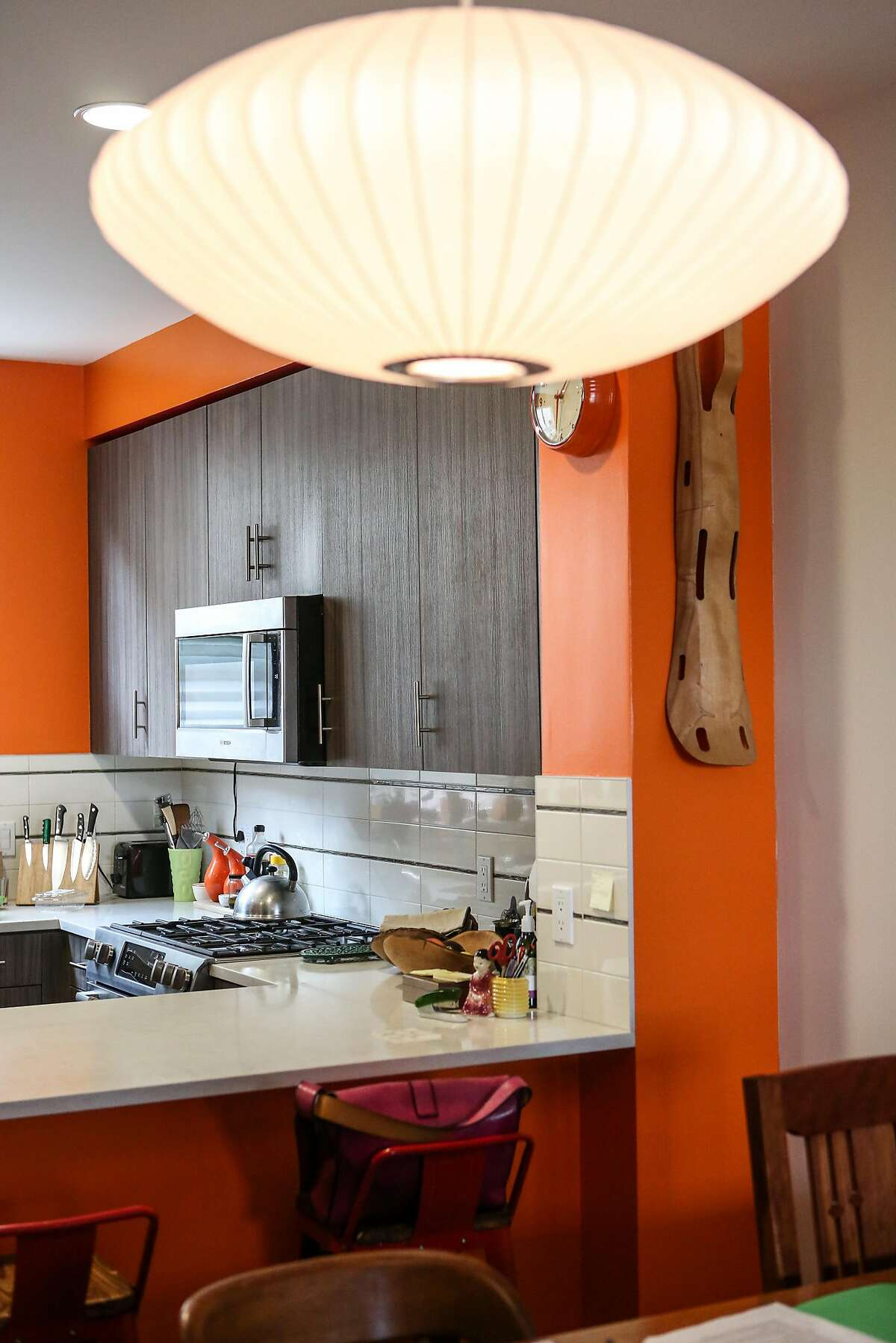 The bright and cheerful kitchen in Nigel Poor and Rick Peterson added unique light fixtures to their townhome in San Francisco, Calif. The townhouse is in the The Shipyard, a large new housing development on former Hunters Point Naval Shipyard.