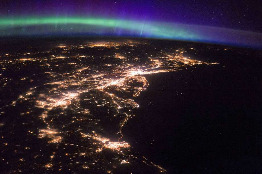 The Northern Lights shine brightly over the Northeast and Canada. New York City and Long Island are glow in the dark sky. The bright lights of Stamford, Norwalk and Bridgeport can be seen on the Connecticut shoreline. The I-91 corridor can also be seen in central Connecticut. Photo: NASA