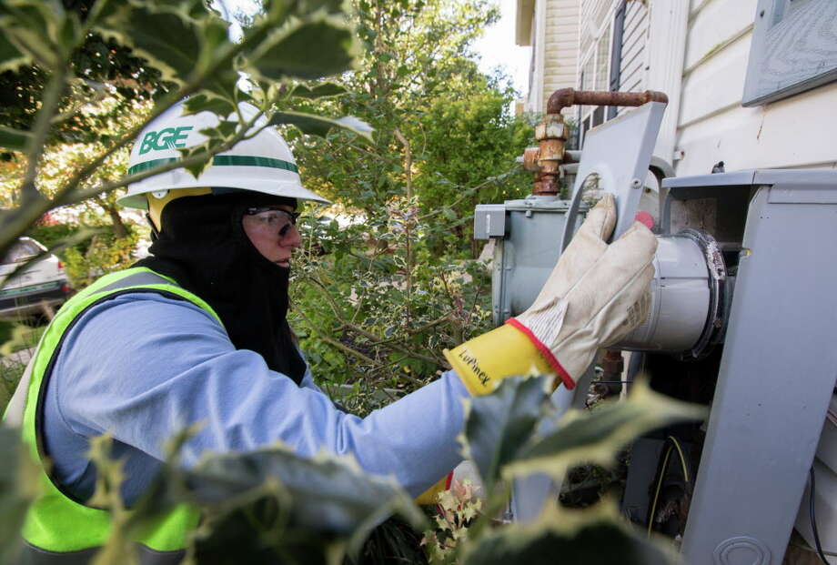 Courtney Lupinek replaces an old model Baltimore Gas and Electric meter with a new Smart meter at a townhouse in Owings Mills, Md., Oct. 24, 2014. Smart meters can help shift consumption to off-peak hours when cleaner, cheaper electricity is available, but so far, customers and public service commissions are not ready for the change. (Nate Pesce/The New York Times) Photo: NATE PESCE / NYTNS