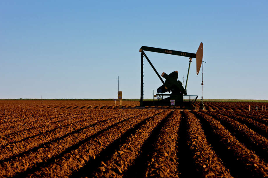 OPEC's pact gave Houston's key industry hope, pushing oil above $50 a barrel for three months. Photo: Courtesy, Jim Blecha / ©2010 Jim Blecha