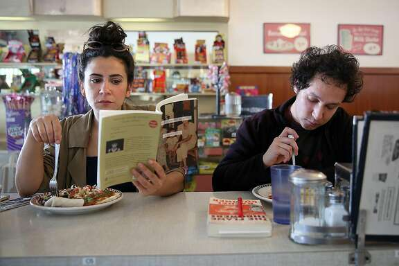 Mercedes Gil (left) has a Huevos Rancheros as Raul Luis  (right) has a NY Reuben at St. Francis Fountain in the Mission on Monday, October 17, 2016, in San Francisco, Calif.