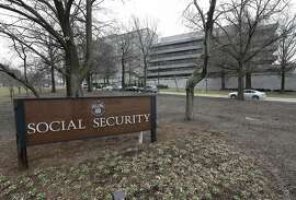 FILE - In this Jan. 11, 2013 file photo, the Social Security Administration's main campus is seen in Woodlawn, Md. Millions of Social Security recipients and federal retirees will get only tiny increases in benefits next year, the fifth year in a row that older Americans will have to settle for historically low raises.  (AP Photo/Patrick Semansky, File)