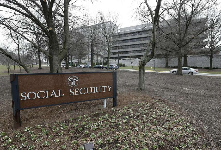 FILE - In this Jan. 11, 2013 file photo, the Social Security Administration's main campus is seen in Woodlawn, Md. Millions of Social Security recipients and federal retirees will get only tiny increases in benefits next year, the fifth year in a row that older Americans will have to settle for historically low raises.  (AP Photo/Patrick Semansky, File) Photo: Patrick Semansky, Associated Press