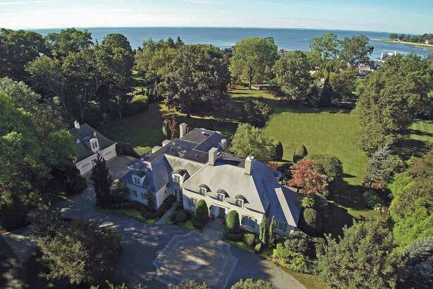 Although the two-acre estate at 1011 Gunston Road does not have direct waterfront it is easy walking distance from Southport Harbor and beach.