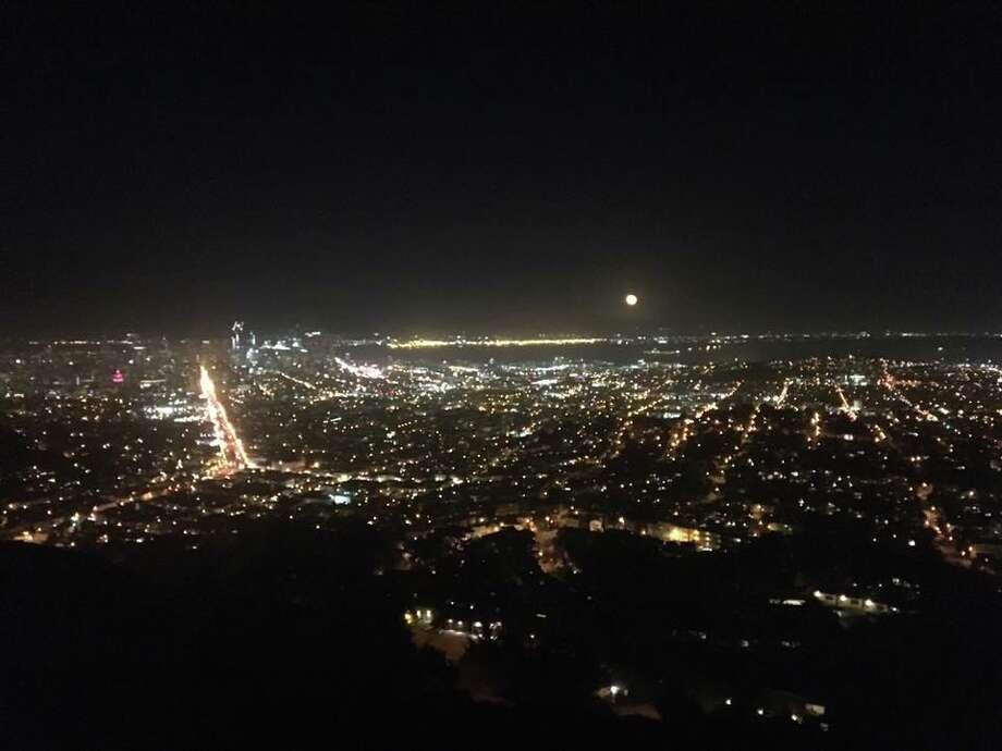 A Hunter's Moon rises above San Francisco on Mon., Oct. 17, 2016. Photo: Yvonne Fae