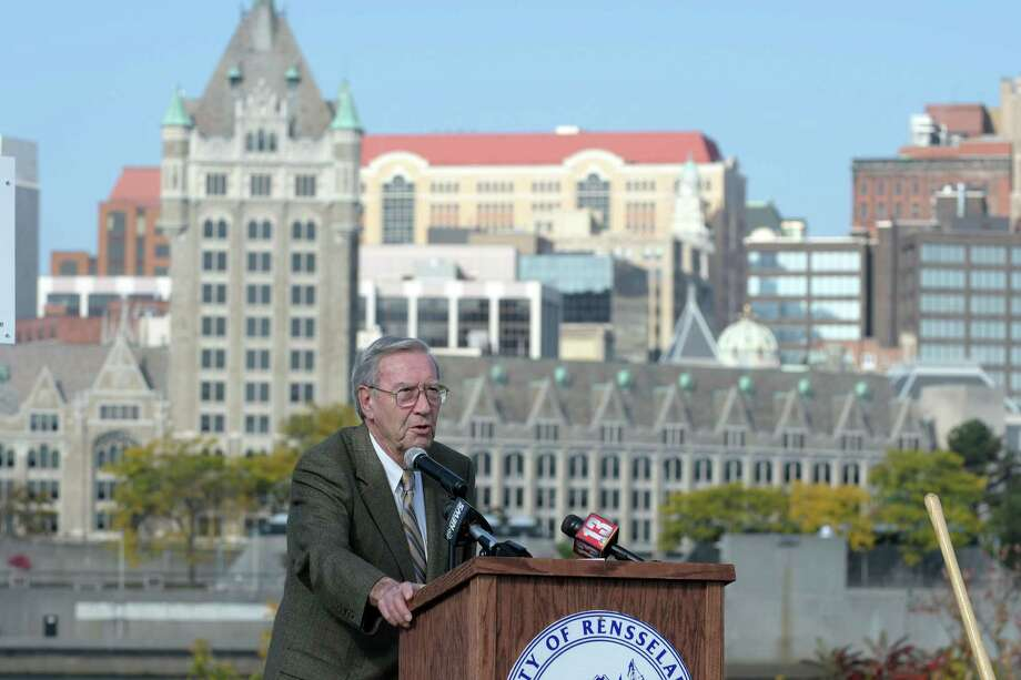 The skyline of Albany is seen across the Hudson River as Rensselaer Mayor Dan Dwyer addresses those gathered for a groundbreaking event for the development of the riverfront on Tuesday, Oct. 18, 2016, in Rensselaer, N.Y.  The plan for the area includes up to 1,000 feet of trail from de Laet's Landing north to the city boat launch on Broadway.  (Paul Buckowski / Times Union) Photo: PAUL BUCKOWSKI / 20038415A