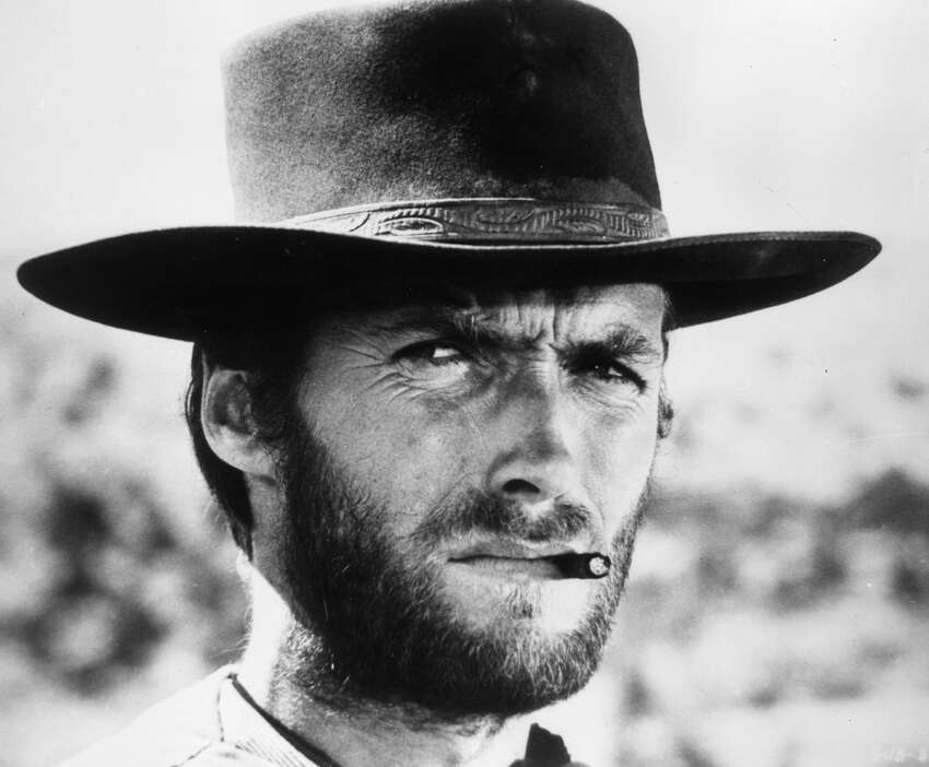 1966: American actor Clint Eastwood squints while smoking a cigarette between his teeth in a still from director Sergio Leone's film 'The Good, The Bad, and The Ugly.' Eastwood wears a wide-brimmed leather hat. (Photo by Hulton Archive/Getty Images)