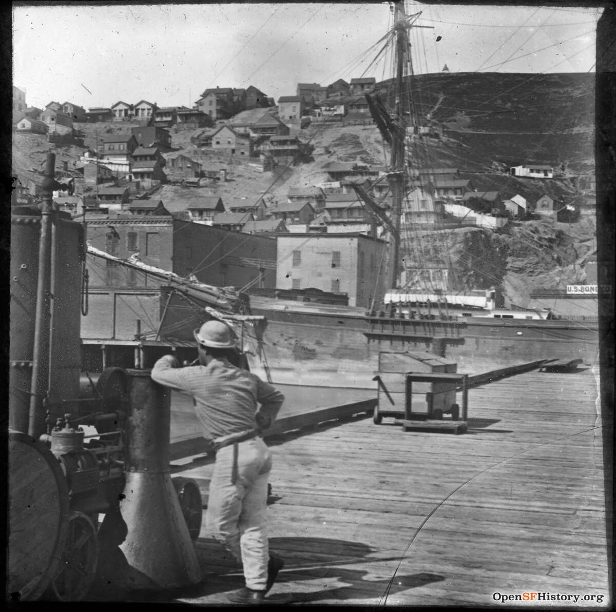 Early, undated photo of Telegraph Hill, from waterfront pier near present Embarcadero. Courtesy of OpenSFHistory.org.