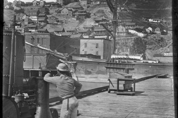 Early, undated photo of Telegraph Hill, from waterfront pier near present Embarcadero. Courtesy of  OpenSFHistory.org .