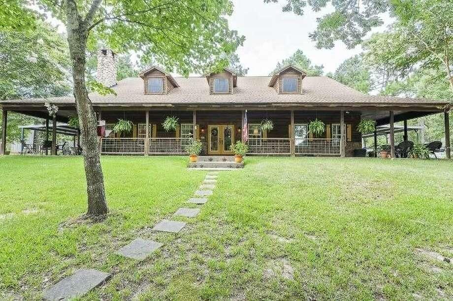4621 Lakewood Dr., Kountze, Texas 776254 bedrooms; 3 full, 1 half bathrooms. 3,600 sq. ft., 10-acre lot. Photo: Realtor.com