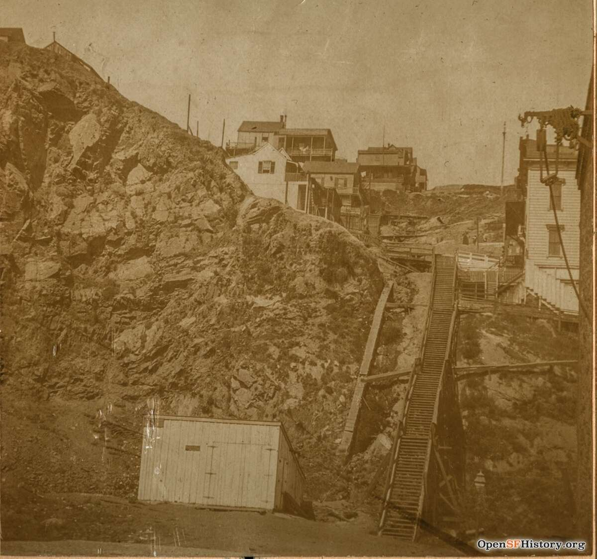 Undated photo of Filbert steps at the base of Telegraph Hill. Wooden stairs, houses, shack. Courtesy of OpenSFHistory.org.