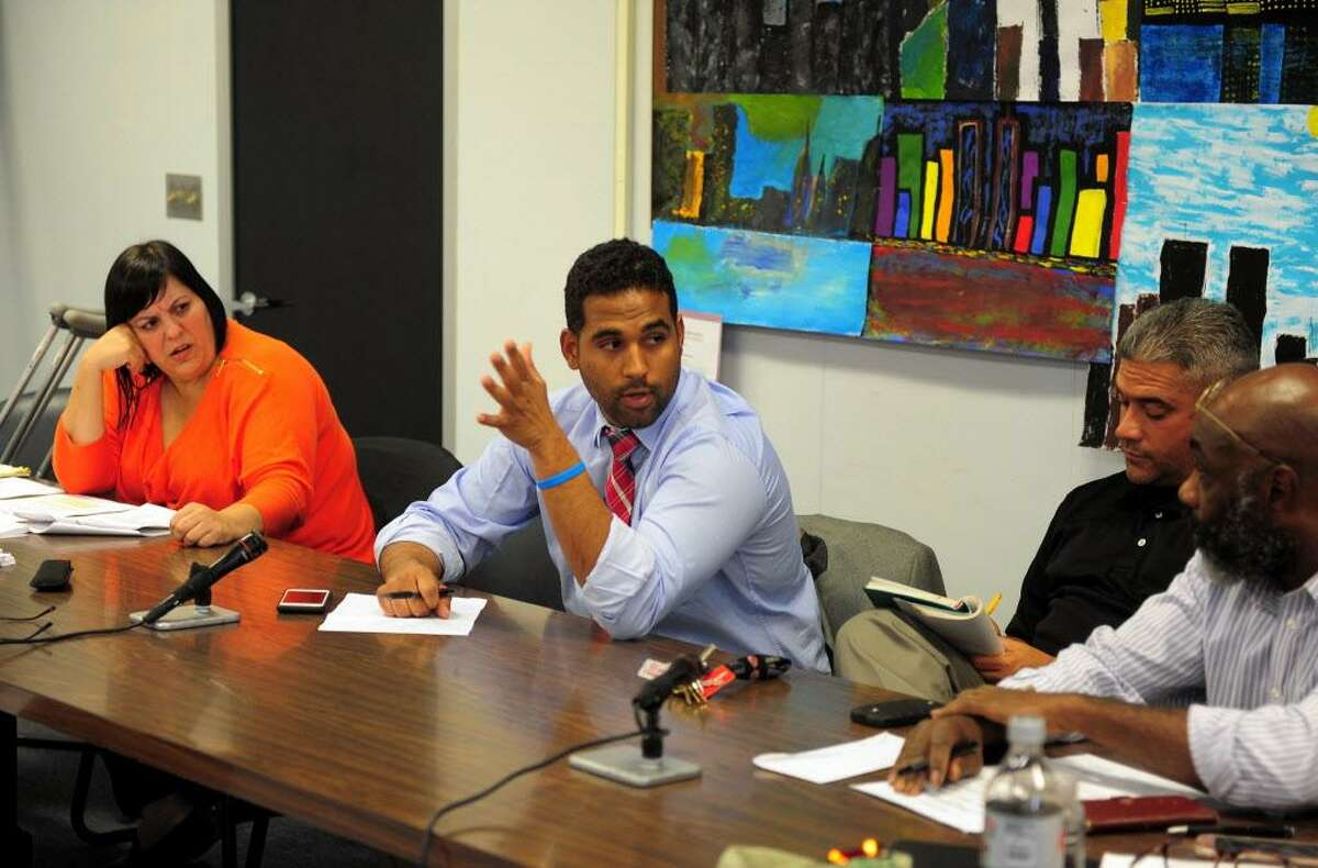 Bridgeport School Board Chairman Dennis Bradley, in center, speaks during a special meeting at City Hall on Oct. 12th. The full board held the meeting in wake of Tuesday night's illegal meeting with one faction of the board held at Geraldine Johnson School.