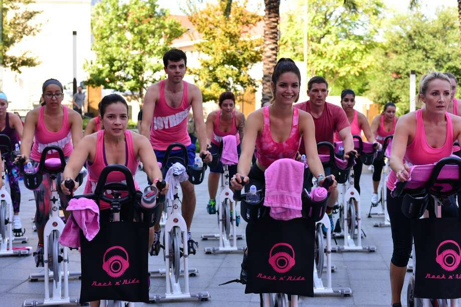 San Antonio cyclists pushed themselves to the limit while raising money for National Breast Cancer Awareness Month on Oct. 7, 2016, at the Tobin Center. The event was hosted by the JoyRide Cycling Studio. Photo: Courtesy