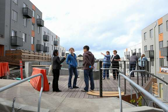 Potential buyers look over the public space that is in construction at the Shipyard, a large new housing development on former Hunters Point Naval Shipyard, on Saturday Oct 15, 2016 in San Francisco, Calif.