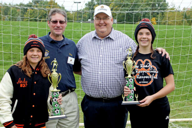 Courtesy Photo   Two local athletes won the Knights of Columbus Michgian State Council Soccer Shootout Challenge, they were (from lft) 12-year-old state champion-Maze Gusa, Saginaw Program Director-Ray Gehlmann, State Program Director-Kevin Rowley, 13-year-old state champion-Josie Gusa.