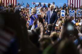 """Hillary Clinton, 2016 Democratic presidential nominee and U.S. Vice President Joseph """"Joe"""" Biden arrive on stage during a campaign event in Scranton, Pennsylvania, U.S., on Monday, Aug. 15, 2016. In a speech on Thursday, Clinton again emphasized her progressive stances on economic issues such as raising the minimum wage, tuition-free public college, expanding Social Security, adding a public insurance option to the Affordable Care Act, and cracking down on Wall Street. Photographer: John Taggart/Bloomberg"""