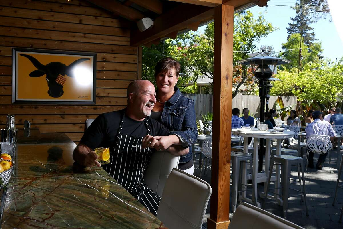 Terri and Mark Stark, who own several Sonoma restaurants, pose at their newest offering, Bravas Bar de Tapas which offers spanish-influenced fare in Healdsburg, Calif., Wednesday, April 17, 2013.