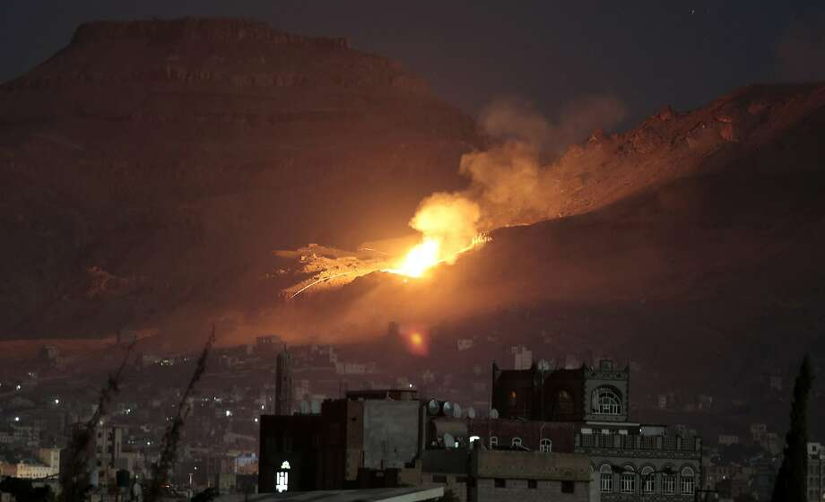 Fire and smoke rise after a Saudi-led air strike hit a weapons depot near the capital, Sanaa, on Friday. Photo: Hani Mohammed, Associated Press