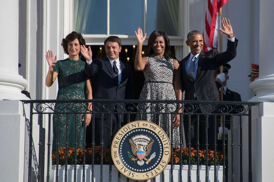 President Obama (right), first lady Michelle Obama, Italian Prime Minister Matteo Renzi and his wife, Agnese Landini, wave from a White House balcony. Photo: JIM WATSON, AFP/Getty Images