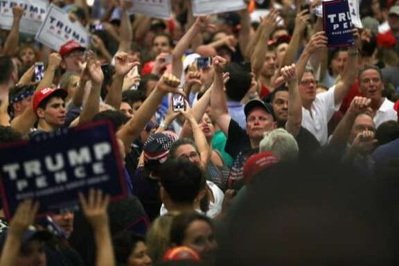 FAIRFIELD, CT - AUGUST 13:  Supporters of Republican Presidential candidate Donald Trump jeer the media on August 13, 2016 in Fairfield, Connecticut. Thousands of people in the traditionally Democratic-leaning state came out to see Trump speak at Sacred Heart University.  (Photo by John Moore/Getty Images)