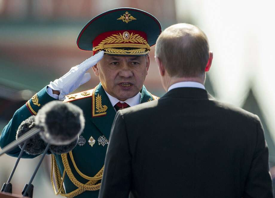 Defense Minister Sergei Shoigu salutes Vladimir Putin during a military parade in Moscow in May. Photo: Alexander Zemlianichenko, Associated Press
