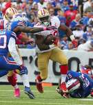 San Francisco 49ers running back Carlos Hyde (28) gains yards during the first half of an NFL football game against the Buffalo Bills on Sunday, Oct. 16, 2016, in Orchard Park, N.Y. (AP Photo/Bill Wippert)