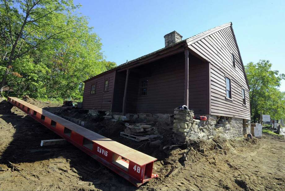 """713 Bedford St.: The Hoyt Barnum House will leave its original Bedford Street site at dawn on Nov. 6, said Roderick Scott, of Davis Building Movers. The home's second floor and roof will be removed and the structure will be transported in two pieces as movers attempt to squeeze the historic structure under the Merritt Parkway underpass. Stamford's oldest home will be relocated to the Historic Society's headquarters on High Ridge Road to make way for the new police station on Bedford Street.  Have a question about a building or property? Email Nora Naughton with """"Point of Interest"""" in the subject line at nora.naughton@scni.com or call 203-964-2263. Photo: Matthew Brown / Hearst Connecticut Media / Stamford Advocate"""