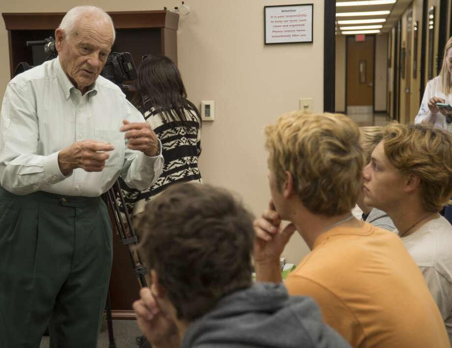 MC golf coach Delnor Poss speaks with some of his current players Tuesday 10-18-16 before his official announcement of his retirement at the end of this school year in 2017. Tim Fischer/Reporter-Telegram Photo: Tim Fischer/Midland Reporter-Telegram