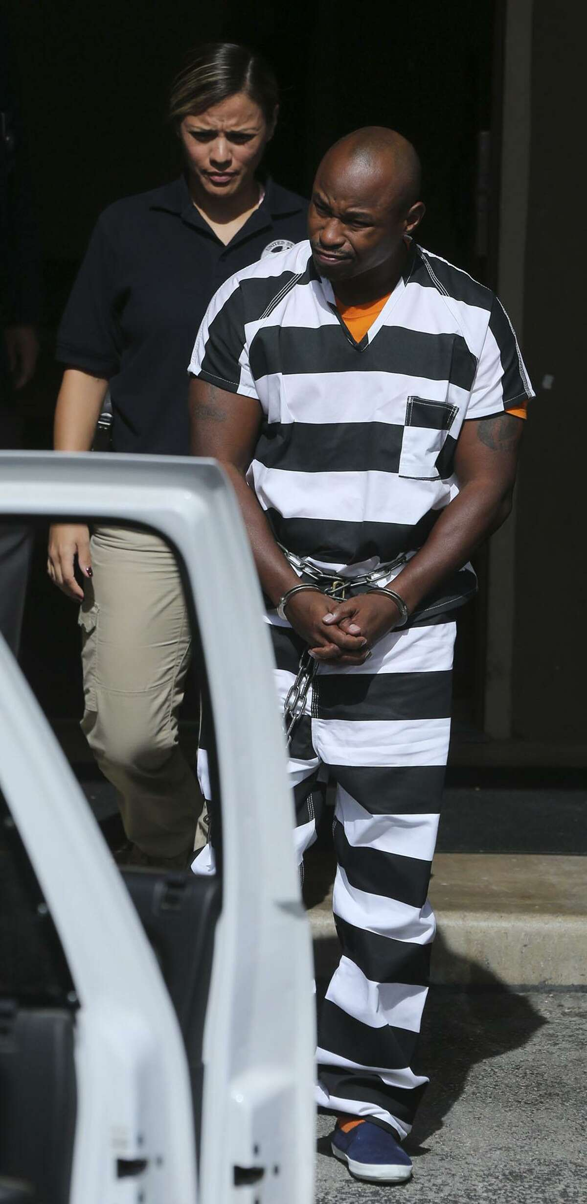 Army Sgt. 1st Class Maliek Kearney,35, is walked to an SUV Tuesday October 18, 2016 at the John H. Wood, Jr. Federal Courthouse after being denied bail. Kearney is fighting a charge that he traveled interstate to kill his wife in Maryland last year.