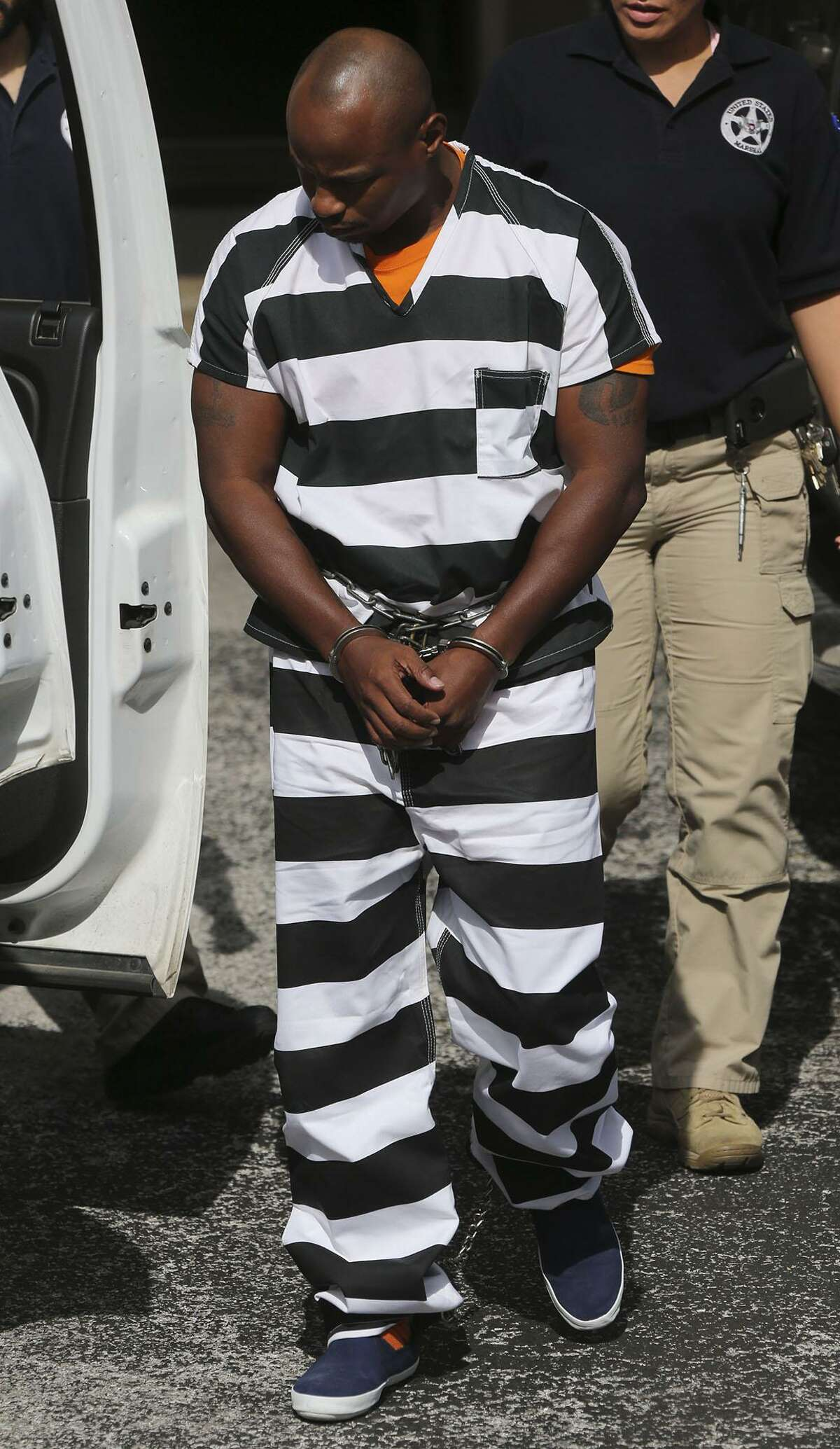 Army Sgt. 1st Class Maliek Kearney,35, is walked to an SUV Tuesday October 18, 2016 at the John H. Wood, Jr. Federal Courthouse after being denied bail. Kearney is fighting a charge that he traveled interstate to kill his wife in Maryland last year. Kearney is assigned to Joint Base San Antonio-Fort Sam Houston.