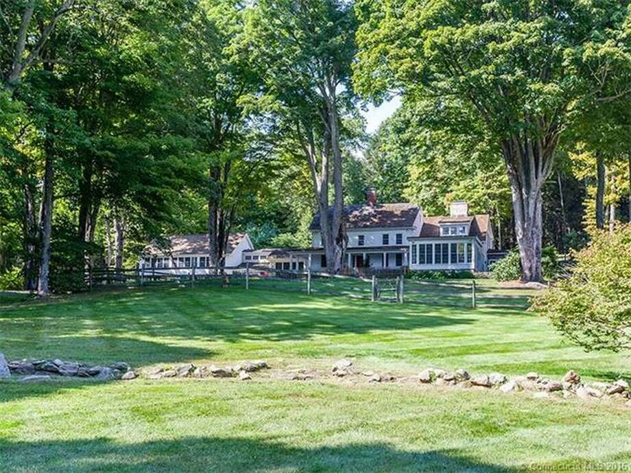 A 51-acre Roxbury estate at 10 Murkland Road, owned by actor Denis Leary and his wife, writer Ann Leary, is on the market for $4.9 million. The colonial-style home features five bedrooms and four bathrooms, a three-bedroom guesthouse, a sport court/ice rink, pool, gym, barn for horses, and game room. Photo: Contributed By Zillow
