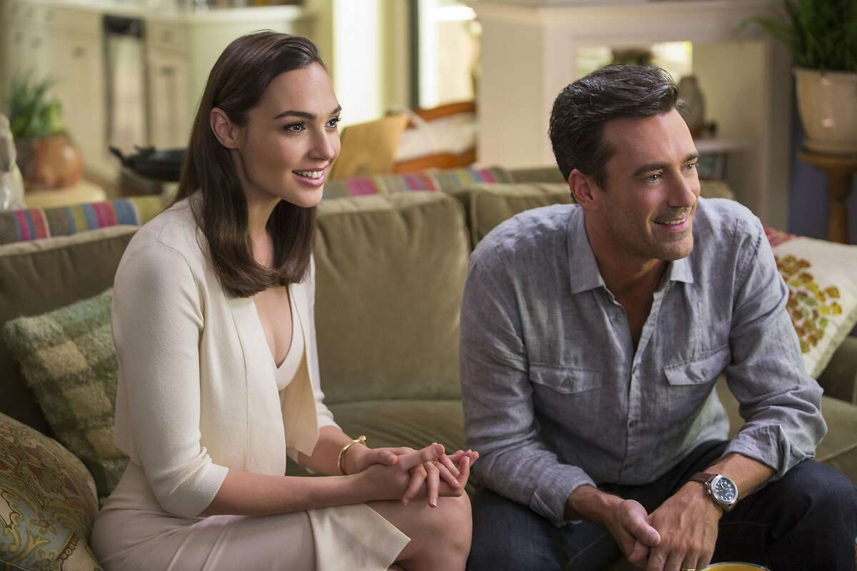 This image released by Twentieth Century Fox shows, Gal Gadot, left, and Jon Hamm in