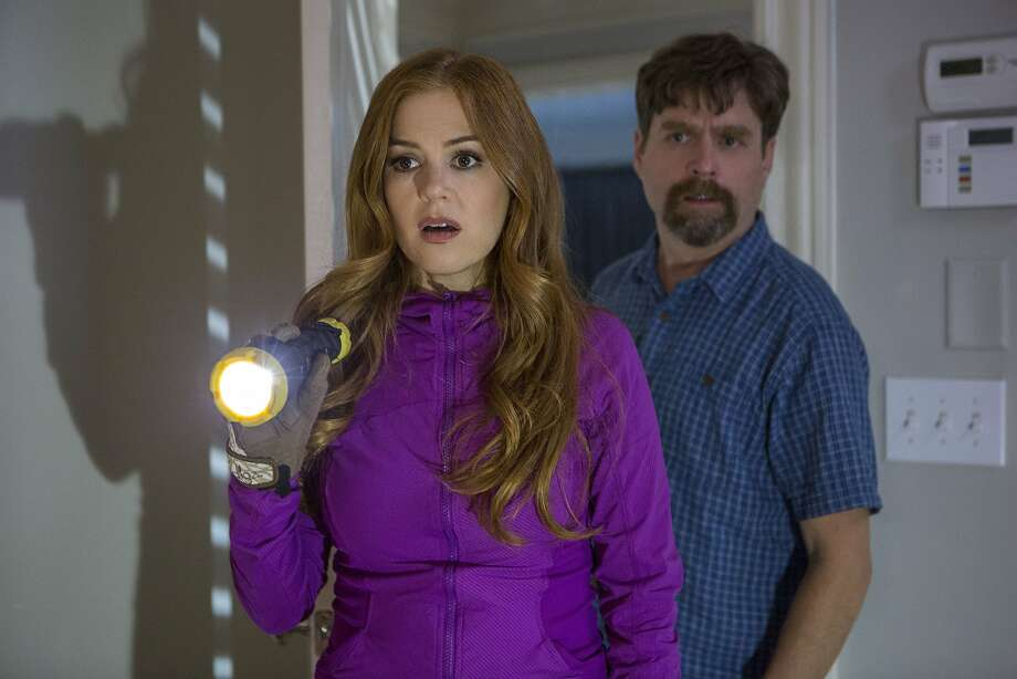 Isla Fisher and Zach Galifianakis are a suburban couple who get nosy about the neighbors. Photo: Frank Masi, Associated Press