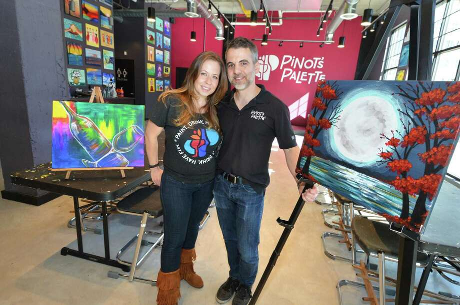 Pinot's Palette Paint and Sip Studio owners Chad and Creative Director Joanne Christena Smith stand in their new Norwalk Conn. location in the Waypointe District on West Ave. on Tuesday October 11, 2016 Photo: Alex Von Kleydorff / Hearst Connecticut Media / Connecticut Post