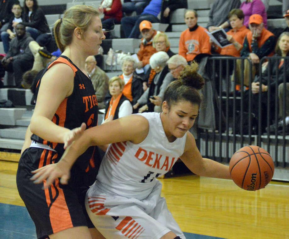 Edwardsville senior Emma Daech guards a DeKalb player during the EHS Holiday Classic.