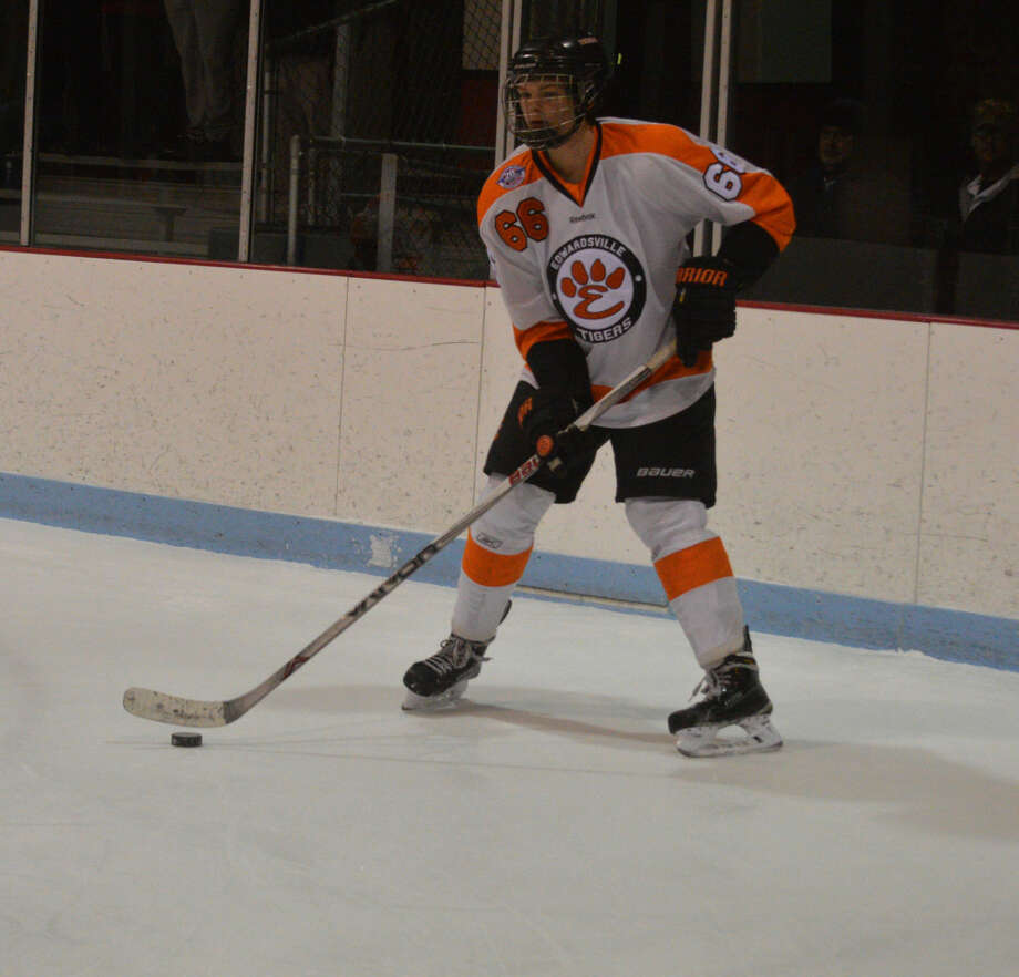 Edwardsville junior Trevor Henson waits to make a pass in the first period of Tuesday's game.